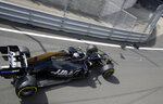 Haas driver Romain Grosjean of France crashes into the guardrails coming out of the pitlane at the start of the first free practice at the Silverstone racetrack, in Silverstone, England, Friday, July 12, 2019. The British Formula One Grand Prix will be held on Sunday. (AP Photo/Luca Bruno)