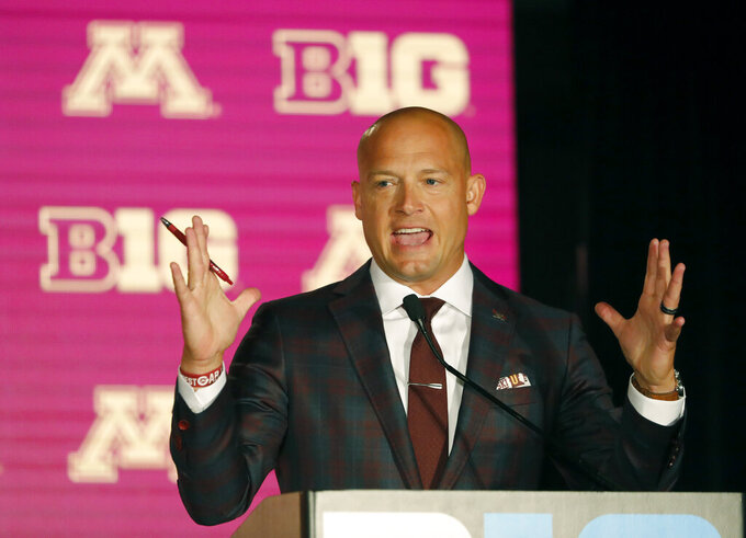 FILE - In this July 18, 2019, file photo, Minnesota head coach P.J. Fleck responds to a question during the Big Ten Conference NCAA college football media days in Chicago. Minnesota returns a major portion of its offense from the strong finish to last season that featured a dominant victory at rival Wisconsin, led by wide receiver Tyler Johnson and running back Mohamed Ibrahim. The next natural feat for P.J. Fleck and the Gophers would be to win the West Division for the first time, as they enter their third season under the energetic head coach. (AP Photo/Charles Rex Arbogast, File)