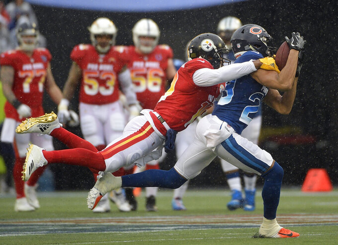 NFC cornerback Kyle Fuller (23), of the Chicago Bears, intercepts a pass intedned for AFC wide receiver Juju Smith-Schuster (19), of the Pittsburgh Steelers, during the first half of the NFL Pro Bowl football game Sunday, Jan. 27, 2019, in Orlando, Fla. (AP Photo/Phelan Ebenhack)