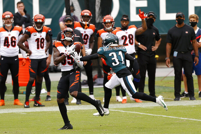 Cincinnati Bengals' Tee Higgins (85) cannot catch a pass against Philadelphia Eagles' Nickell Robey-Coleman (31) during overtime of an NFL football game, Sunday, Sept. 27, 2020, in Philadelphia. (AP Photo/Laurence Kesterson)