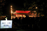 A line of people stand at the ticket area as they wait to enter Terror Town, Saturday, Oct. 17, 2020, in Williamsburg, Ohio. In a year when fear and death have commandeered front-row seats in American life, what does it mean to encounter Halloween, a holiday whose very existence hinges on turning fear and death into entertainment? (AP Photo/Aaron Doster)