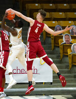 Washington State forward Aljaz Kunc, right, blocks a shot by Colorado guard McKinley Wright IV during the first half of an NCAA college basketball game Wednesday, Jan. 27, 2021, in Boulder, Colo. (AP Photo/David Zalubowski)