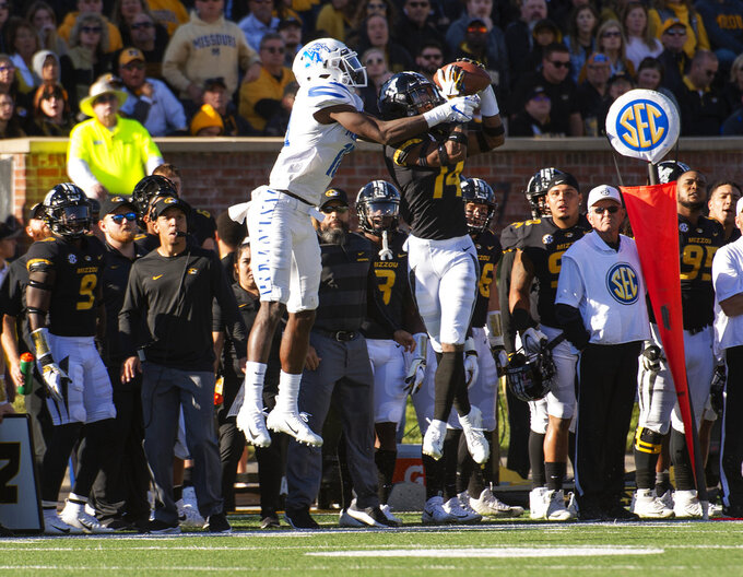 Missouri defensive back Adam Sparks, right, intercepts a pass in front of Memphis wide receiver Damonte Coxie, left, during the first half of an NCAA college football game Saturday, Oct. 20, 2018, in Columbia, Mo. (AP Photo/L.G. Patterson)