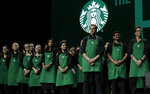 Starbucks baristas stand on stage, Wednesday, March 20, 2019, during Starbuck's annual shareholders meeting in Seattle. (AP Photo/Ted S. Warren)