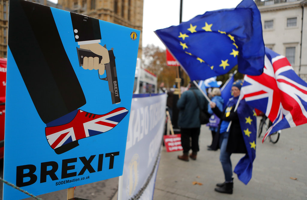 Brexit deal in turmoil as vote delayed