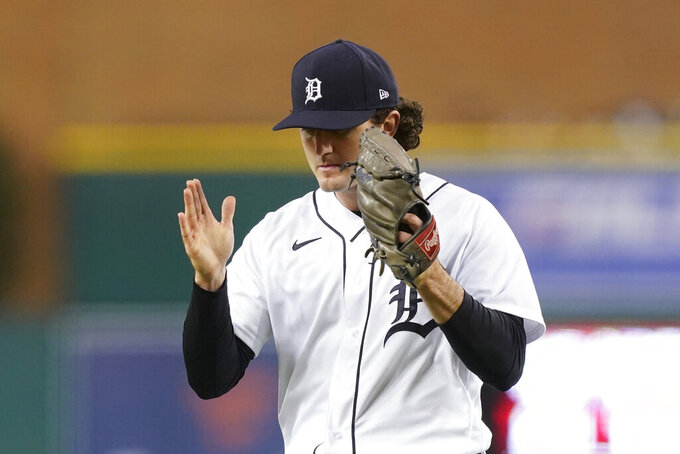 Detroit Tigers starting pitcher Casey Mize reacts after the last out in during the sixth inning of a baseball game against the Kansas City Royals, Wednesday, May 12, 2021, in Detroit. (AP Photo/Carlos Osorio)