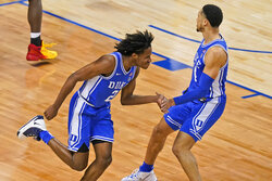 Duke guard DJ Steward (2) celebrates a basket with teammate Duke guard Jordan Goldwire, right, during the second half of an NCAA college basketball game in the second round of the Atlantic Coast Conference tournament in Greensboro, N.C., Wednesday, March 10, 2021. Duke defeated Louisville 70-56. (AP Photo/Gerry Broome)
