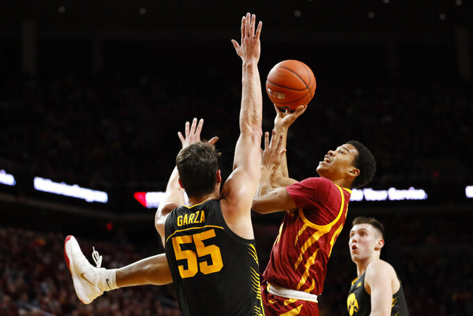 Iowa State guard Rasir Bolton drives to the basket over Iowa center Luka Garza (55) during the first half of an NCAA college basketball game, Thursday, Dec. 12, 2019, in Ames, Iowa. (AP Photo/Charlie Neibergall)