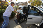 Dirk Collins helps evacuate his brother Darin from their home in Healdsburg, Calif., on Saturday, Oct. 26, 2019. The entire communities of Healdsburg and Windsor were ordered to evacuate ahead of strong winds that could lead to erratic fire behavior near the blaze burning in wine country. The Sonoma County Sheriff's Office said it would be the biggest evacuation in the county in more than 25 years. (John Burgess/The Press Democrat via AP)