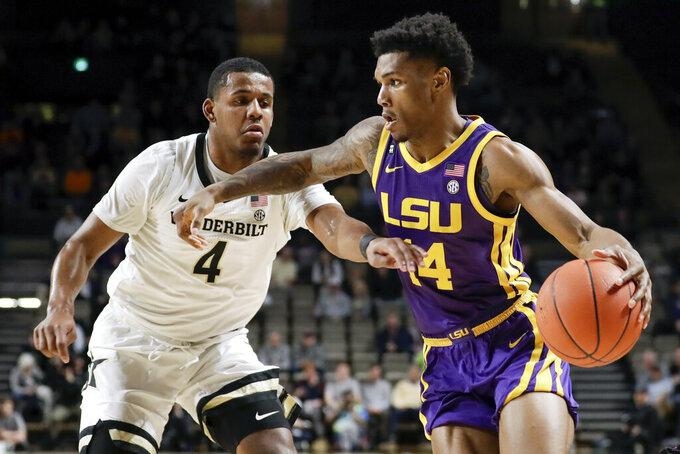 LSU guard Marlon Taylor (14) drives against Vanderbilt's Jordan Wright (4) in the first half of an NCAA college basketball game Wednesday, Feb. 5, 2020, in Nashville, Tenn. (AP Photo/Mark Humphrey)