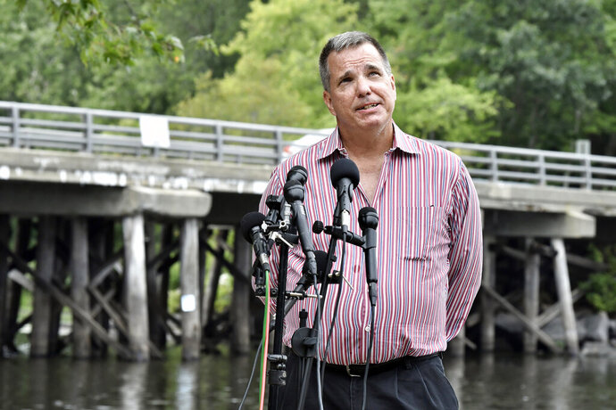 Joe Desiato, whose son U.S. Marine Lance Cpl. Travis Desiato was killed in 2004, speaks to reporters Thursday, Sept. 10, 2020, in Bedford, Mass. The families of two servicemen from Bedford, Mass., killed in action in Iraq addressed reports of President Trump's statement on military service by the bridge named as a memorial to their sons. (AP Photo/Josh Reynolds)
