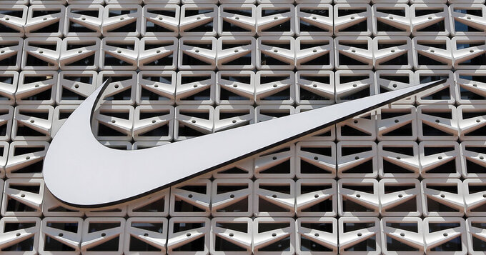 FILE - This Aug. 8, 2017 file photo shows the Nike logo at a store in Miami Beach, Fla.  Nike's shares are soaring before the opening bell Friday, June 25, 2021, as the footwear and clothing company posted record fiscal fourth-quarter sales in North America and gave a better-than-anticipated full-year revenue forecast. (AP Photo/Alan Diaz, File)