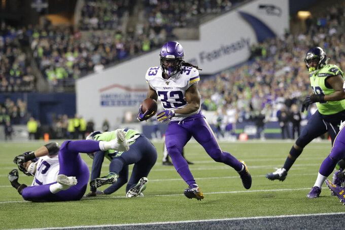Minnesota Vikings' Dalvin Cook (33) scores against the Seattle Seahawks during the first half of an NFL football game, Monday, Dec. 2, 2019, in Seattle. (AP Photo/Ted S. Warren)