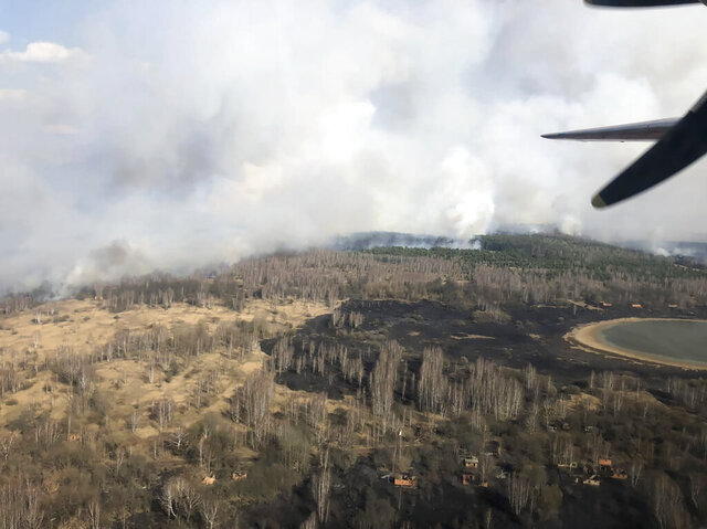 In this photo made on Saturday, April 4, 2020, an aerial view of a forest fire burning near the village of Volodymyrivka in the exclusion zone around the Chernobyl nuclear power plant, Ukraine. The fire was still burning on Sunday, April 5, Emergency Ministry firemen kept extinguishing the fire. (Emergency Situation Ministry via AP)