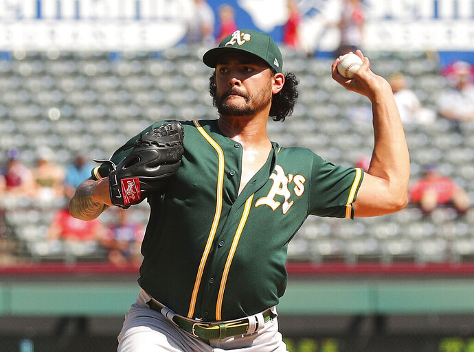 Oakland Athletics starting pitcher Sean Manaea (55) throws against the Texas Rangers in the fourth inning of a baseball game Sunday, Sept. 15, 2019, in Arlington, Texas. (AP Photo/Richard W. Rodriguez)