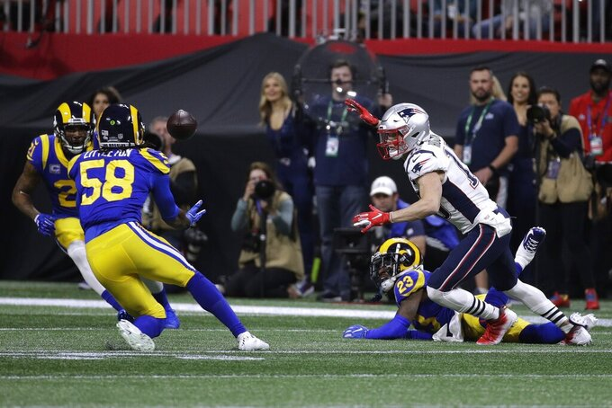 Los Angeles Rams' Cory Littleton (58) intercepts a pass intended for New England Patriots' Chris Hogan, right, during the first half of the NFL Super Bowl 53 football game Sunday, Feb. 3, 2019, in Atlanta. (AP Photo/Patrick Semansky)