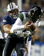 BYU defensive lineman Khyiris Tonga, rebar, sacks Hawaii quarterback Cole McDonald during an NCAA college football game Saturday, Oct. 13, in Provo, Utah. (Isaac Hale/Daily Herald via AP)