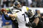 FILE - In this Oct. 27, 2013, file photo, Pittsburgh Steelers quarterback Ben Roethlisberger (7) is hit by Oakland Raiders outside linebacker Kevin Burnett, rear, and defensive tackle Vance Walker (98) while passing during the fourth quarter of an NFL football game in Oakland, Calif. The Oakland Coliseum has been a bit of a house of horrors for Roethlisberger in his career. (AP Photo/Ben Margot, File)
