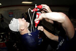 Los Angeles Dodgers second baseman Gavin Lux is doused with beer by teammates during a locker room celebration after the Dodgers defeated the Baltimore Orioles 7-3 during a baseball game Tuesday, Sept. 10, 2019, in Baltimore. The Dodgers clinched the NL West title. (AP Photo/Julio Cortez)