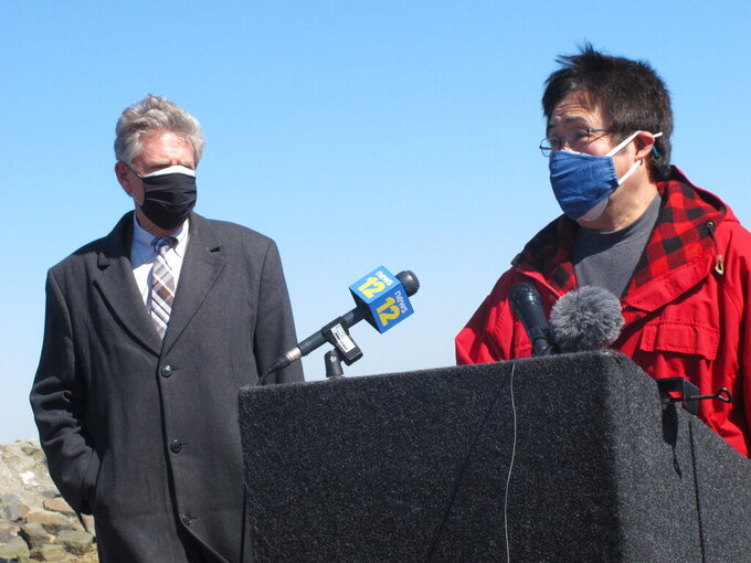 U.S. Rep. Frank Pallone Jr., left, listens as Jung Kim, right, speaks at a news conference Monday, March 8, 2021 in Middletown N.J. Kim says his bait and tackle shop sustained losses of 60 to 65% last year amid the coronavirus pandemic, and says two rounds of federal aid will help him keep his doors open this year. (AP Photo/Wayne Parry)