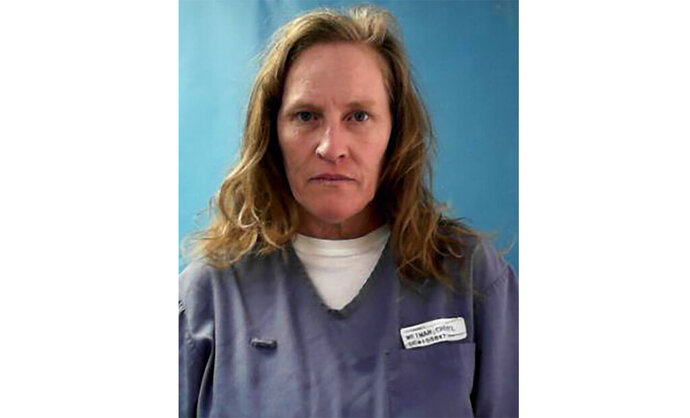 This photo provided by Florida Department of Corrections shows Cheryl Weimar. Weimar, an inmate at a Florida prison is suing the state corrections agency, Thursday, Sept. 5, 2019, saying she was left paralyzed after being beaten by four guards.  Weimar, and her husband, Karl, said in their lawsuit that her civil rights were violated when she was nearly beaten to death by guards at the Lowell Correctional Institution last month.   (Florida Department of Corrections via AP)