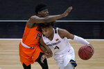 Oklahoma State's Bryce Williams (14) pressures West Virginia's Miles McBride (4) during the second half of an NCAA college basketball game in the second round of the Big 12 Conference tournament in Kansas City, Mo., Thursday, March 11, 2021. Oklahoma State won 72-69. (AP Photo/Charlie Riedel)