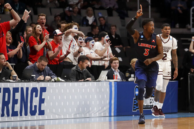 Liberty guard Lovell Cabbil Jr. celebrates after scoring against Mississippi State during the second half of a first-round game in the NCAA men's college basketball tournament Friday, March 22, 2019, in San Jose, Calif. (AP Photo/Jeff Chiu)