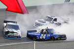 Chase Elliott (24) and Brett Moffitt (23) spin out during a NASCAR Truck Series auto race Saturday, June 13, 2020, in Homestead, Fla. (AP Photo/Wilfredo Lee)