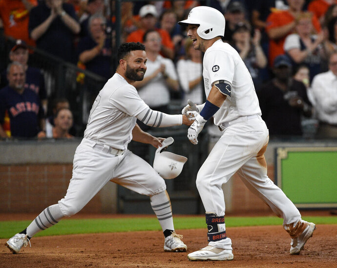 Houston Astros' Alex Bregman, right, celebrates his three-run home run off Los Angeles Angels starting pitcher Dillon Peters with Jose Altuve during the third inning of a baseball game Saturday, Aug. 24, 2019, in Houston. (AP Photo/Eric Christian Smith)