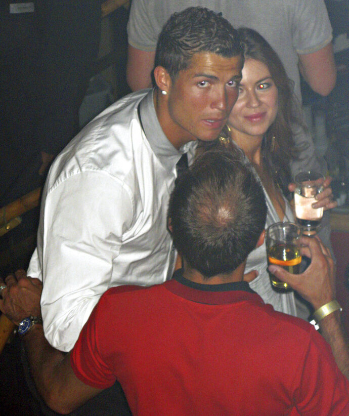In this June 2009 photo made available to the Associated Press on Friday Oct. 5, 2018, soccer star Cristiano Ronaldo is pictured with Kathryn Mayorga in Rain Nightclub in Las Vegas. A lawyer for Mayorga, who is alleging that Ronaldo raped her in Las Vegas in 2009 said her client was