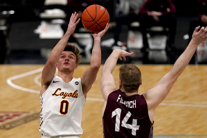 Loyola of Chicago's Paxson Wojcik (0) shoots over Southern Illinois' Kyler Filewich (14) during the second half of an NCAA college basketball game in the quarterfinal round of the Missouri Valley Conference men's tournament Friday, March 5, 2021, in St. Louis. (AP Photo/Jeff Roberson)