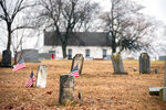 In this undated photo grave stones sit near Fawn AME Zion Church in Fawn Township looking from the oldest part of the cemetery, in New Park, Pa. The original log church was closer to the cemetery that is the final resting place of Civil War soldiers and people born in the early 1800's. (Paul Kuehnel/York Daily Record via AP)
