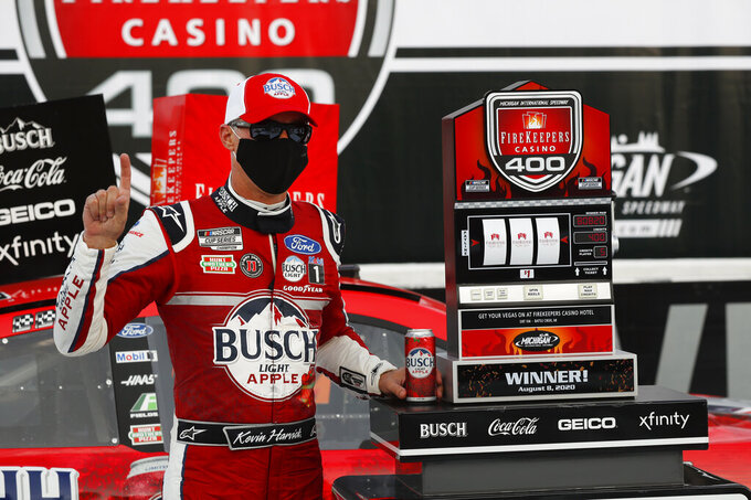 Kevin Harvick celebrates after winning a NASCAR Cup Series auto race at Michigan International Speedway in Brooklyn, Mich., Saturday, Aug. 8, 2020. (AP Photo/Paul Sancya)