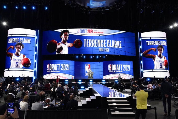 A tribute to former Kentucky guard Terrence Clarke is presented on screens during the NBA basketball draft, Thursday, July 29, 2021, in New York. Clarke died in a car accident in April. (AP Photo/Corey Sipkin)