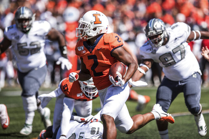 Illinois' Reggie Corbin (2) runs the ball in the second half of a NCAA college football game against Eastern Michigan, Saturday, Sept.14, 2019, in Champaign, Ill. (AP Photo/Holly Hart)