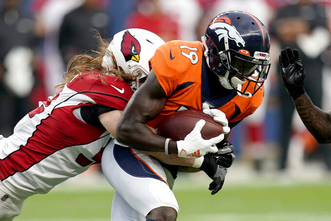 Denver Broncos wide receiver Fred Brown (19) makes the catch as Arizona Cardinals linebacker Brooks Reed defends during the first half of an NFL preseason football game, Thursday, Aug. 29, 2019, in Denver. (AP Photo/Jack Dempsey)