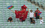 Fans cheer prior the start of the Euro 2020 soccer championship group A match between Turkey and Wales the Baku Olympic Stadium in Baku, Azerbaijan, Wednesday, June 16, 2021. (AP Photo/Darko Vojinovic, Pool)