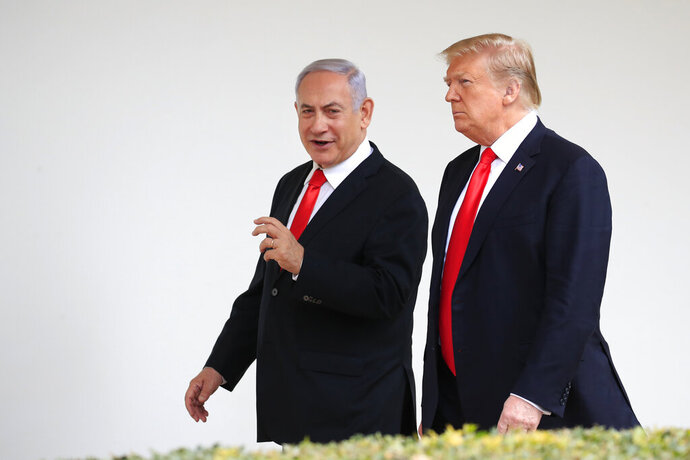 FILE - In this March 25, 2019, file photo, President Donald Trump and visiting Israeli Prime Minister Benjamin Netanyahu walk along the Colonnade of the White House in Washington. Netanyahu on Wednesday, Aug. 21, 2019, is steering clear of Trump's comments questioning the loyalty of American Jews who support the Democratic Party, ignoring condemnation from Jewish critics who accuse him of voicing longstanding anti-Semitic tropes. (AP Photo/Manuel Balce Ceneta, File)