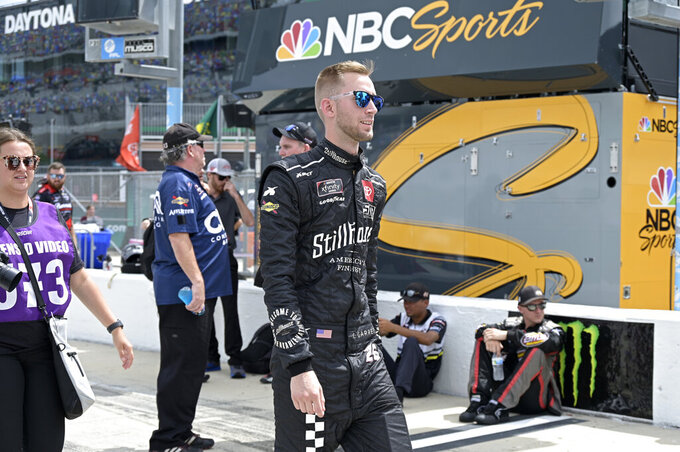 Driver Colin Garrett (26) walks to his vehicle on pit road before a NASCAR Xfinity Series auto race at Daytona International Speedway, Saturday, Aug. 28, 2021, in Daytona Beach, Fla. (AP Photo/Phelan M. Ebenhack)