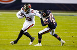 Tampa Bay Buccaneers wide receiver Mike Evans (13) is tackled by Chicago Bears cornerback Jaylon Johnson (33) during the second half of an NFL football game in Chicago, Thursday, Oct. 8, 2020. (AP Photo/Nam Y. Huh)