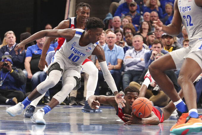 Memphis Damion Baugh (10) and Illinois-Chicago Travell Washington (35) go for a loose ball during the second half of an NCAA college basketball game, Friday, Nov. 8, 2019, in Memphis, Tenn. (AP Photo/Karen Pulfer Focht)