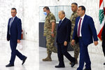 Lebanese President Michel Aoun, center, arrives to attend a cabinet meeting at the presidential palace in Baabda, east of Beirut, Lebanon, Monday, Sept. 13, 2021. (AP Photo/Bilal Hussein)