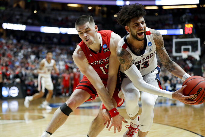 Gonzaga guard Josh Perkins, right, pulls the ball away from Texas Tech guard Matt Mooney during the second half of the West Regional final in the NCAA men's college basketball tournament Saturday, March 30, 2019, in Anaheim, Calif. (AP Photo/Marcio Jose Sanchez)