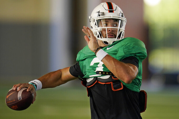 FILE - In this Thursday, Aug. 12, 2021, file photo, Oklahoma State quarterback Spencer Sanders throws during an NCAA college football practice in Stillwater, Okla. (AP Photo/Sue Ogrocki, File)
