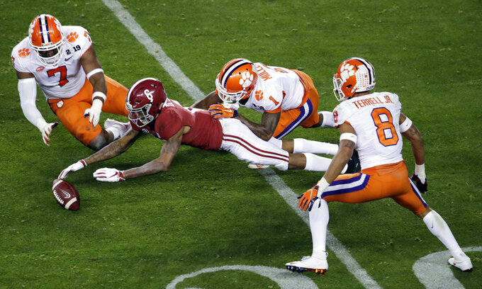 Alabama's DeVonta Smith goes for a loose ball during the second half of the NCAA college football playoff championship game against Clemson, Monday, Jan. 7, 2019, in Santa Clara, Calif. (AP Photo/Jeff Chiu)