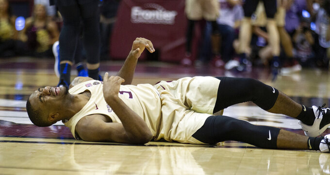 Florida State guard Trent Forrest cramps up late in the second half of an NCAA college basketball game against Duke in Tallahassee, Fla., Saturday, Jan. 12, 2019. Duke defeated Florida State 80-78. (AP Photo/Mark Wallheiser)