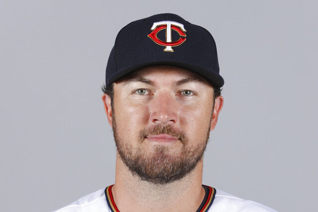 """FILE - This is a 2018 file photo showing Minnesota Twins baseball player Phil Hughes. Phil Hughes has retired from baseball, more than two years after throwing his last pitch. The 34-year-old right-hander said on Twitter on Sunday, Jan. 3, 2021, he was announcing what's been """"fairly apparent""""  to most of these last couple years."""" (AP Photo/John Minchillo, File)"""
