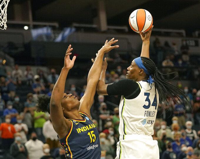 Minnesota Lynx Sylvia Fowles (34) shoots over Indiana Fever's Teaira McCowan (15) during the first quarter of a WNBA basketball game Sunday, Sept. 12, 2021, in Minneapolis. (David Joles/Star Tribune via AP)