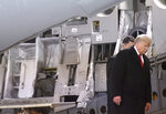 President Donald Trump disembarks a C-17 aircraft after a prayer for Sgt. 1st Class Javier Jaguar Gutierrez and Sgt. 1st Class Antonio Rey Rodriguez, Monday, Feb. 10, 2020, at Dover Air Force Base, Del. According to the Department of Defense, Gutierrez, 28, of San Antonio, and Rodriguez, 28, of Las Cruces, N.M., died in Nangarhar province, Afghanistan, of wounds sustained during combat operations. (AP Photo/Steve Ruark)