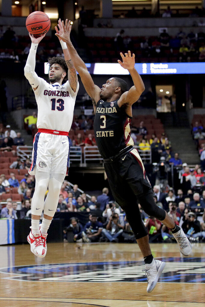 Gonzaga guard Josh Perkins, left, shoots over Florida State guard Trent Forrest during the first half an NCAA men's college basketball tournament West Region semifinal Thursday, March 28, 2019, in Anaheim, Calif. (AP Photo/Jae C. Hong)